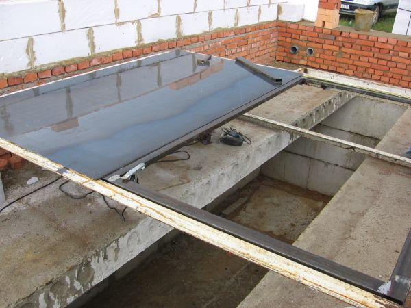 Установка плит перекрытия и создание смотровой ямы